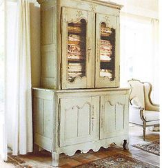 French armoire filled with linens from Brooke Gianetti at Velvet & Linen