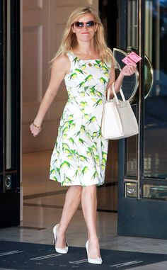 Dainty, delightful, delicate? Must be Reese! She rules the street style game again in a cheery parakeet-print, Carolina Herrera frock.