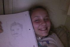A picture that I drew... Ignore my face and look at his. LOL!