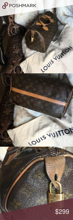 AUTHENTIC LOUIS VUITTON SPEEDY  30 This Authentic LV SPEEDY 30 dates back to late 1970s, before Date Codes were stamped inside the ag!!!. The darkness of the handles is a result of the body's natural oils' interaction  The inside of the bag has ink stains. There is one that comes through the bottom of the bag. See picts. Reduced price does not include Authentic Preservation bag or lock and key.  The low price is in consideration of flaws. (Ref ICTS. Please view my Posh Stats& Client's…