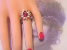 Hey, I found this really awesome Etsy listing at https://www.etsy.com/ca/listing/69227593/vintage-gold-ring-with-red-rhinestone