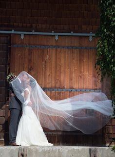 Love this type of photo. Worth getting a cathedral length veil, just for this! :) Super fun and beautiful.