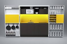 """Compact Kitchen folds up and """"disappears"""". Like the concept and easy enough to build, just needs better colours."""