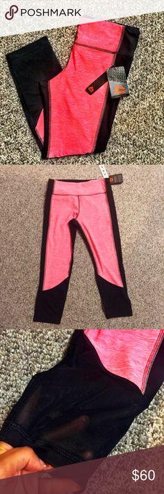 reebok // mesh detail running tights NWT RBX salmon and black running tights with mesh detailing at the calf. Fits TTS. Reebok Pants Leggings