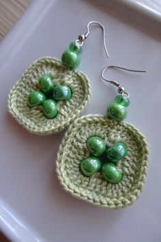 Stylish, comfortable and lightweight earrings for every day. I used green cotton thread and dark green beads. Designed by me. MATERIAL: cotton yarn, ceramic/glass beads, hooks for earrings are nickel-free, lead free and cadmium free. SIZE: Dimensions - 1,4 x 1,4 in (3,5 x 3,5 cm) Whole