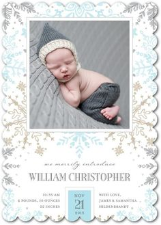 We're in love with this blue snowflake birth announcement. Look how comfy this baby boy looks!