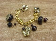 Gold charm bracelet with charms