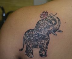 Love my elephant tattoo!!! Artist Chani Murat- Seattle, WA ...I want this but I want the trunk to hold a RED hibiscus flower; it's in memory of my grandfather who was hawaiian and a huge Alabama football fan :)
