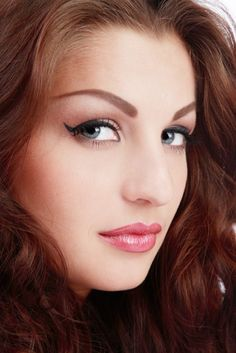Close-up portrait of beautiful blue-eyed girl with permanent makeup including eyebrows, eyeliner and lip liner. #medspa