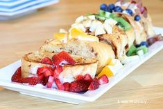 """This is Stuffed French Toast, with a rainbow of fruit inspired deliciousness.Its Healthy and Colorful.Rich and Tasty.Pretty and Pleasing.I will stop with the adjetives now and show you the goods!I have made these bad boys once before, but only with blueberries. I asked the kids if they wanted blueberry or strawberry and they said, """"Banana!"""" """"Grape!"""" and """"Yes!"""" simulantiously.It was all very confusing.And inspiring!So I got all the fruit toget"""