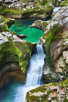 emerald pool in mostnica gorge, slovenia