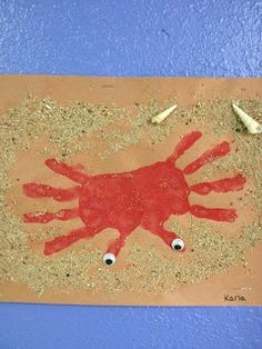 Themed craft idea to go with A House for Hermit Crab by Eric Carle!  So cute and fun!  Handprint crab.