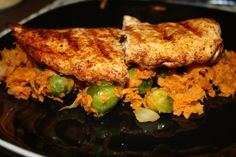 Chili rubbed grilled chicken with sweet potato and baby Brussels sprouts hash! Delish!