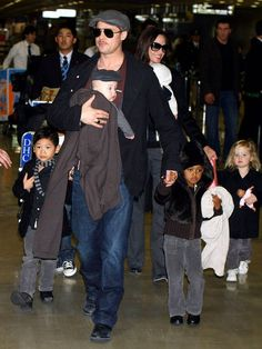 The whole family held hands walking through Narita International Airport in January 2009.