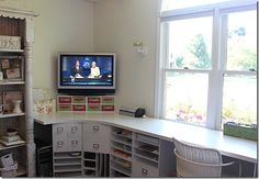 This is fabulous and so much space...I need a TV in my craft room!
