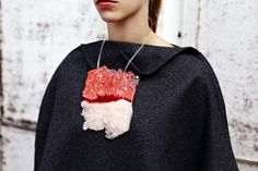 Black Poncho by Erin Lewis, Resin Necklace by Ashleigh Downer all at LCF's COLLEGE SHOP at Carnaby Street