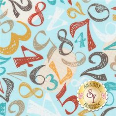 This fabric features varying sizes of the numbers 0-9 tossed on a light aqua background.