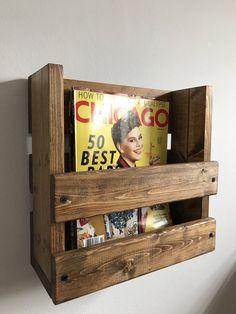 Rustic magazine rack, Wall mounted magazine holder, Wood magazine storage, Wood rack, Magazines, Home decor, Rustic storage, Wood organizer by BlackIronworks on Etsy https://www.etsy.com/listing/510630510/rustic-magazine-rack-wall-mounted