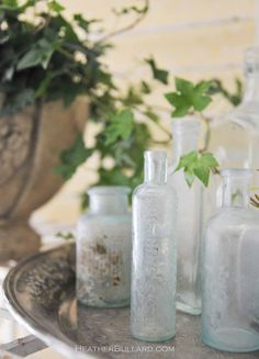 having a bunch of these bottles on hand, I love the idea of displaying some of them on a silver tray. seen on Heather Bullard. Antique Glass Bottles, Apothecary Bottles, Vintage Bottles, Bottles And Jars, French Cottage Garden, Silver Trays, Mason Jar Lamp, Glass Collection, Event Decor
