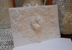Handmade Greeting Card for all occassions, white heavy card stock, cream, white, ivory, battenburg doily, fabric flower with rhinestone, blank inside with matching envelope. Will be send in protective Cellophane sheet. Give for birthdays, special holidays, friendship, teacher's gifts, great for giving out at home shopping parties, bridal shower gifts for door prizes, additional gift …