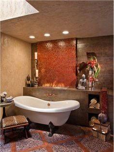 Dramatic Transitional Bathroom with an Asian theme with a Clawfoot tub and and 'Charcoal Black' pebble tiled floors. Glass tile on the wall with a fire crystal fireplace