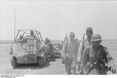 """Erwin Rommel on his command half-track """"Grief"""" and Afrikakorps infantry. North Africa 1942"""