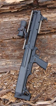 Kel-Tec KSG Shotgun. Load it with buck-shot and slugs. Switch between the two on the fly. Crazy shotgun.