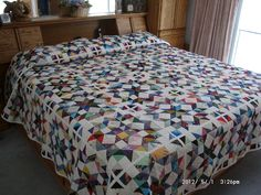 Scrappy Quilt with white sashing and binding (see reverse side picture for scrappy with black sashing and binding).