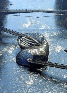 Graz, Austria. Ermahgerd, it's a floating coffee shop.  GRAZ is where my grandfather was born and grew up!  So cool!