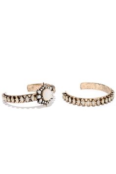 """Thank the accessory gods for bestowing the Temple of the Sun Gold and Cream Rhinestone Bracelet Set upon us! A set of two antiqued gold bracelets are embellished with cream rhinestones, while a round gem sits at center surrounded by a spiked motif. Bracelet has a 2.5"""" diameter."""