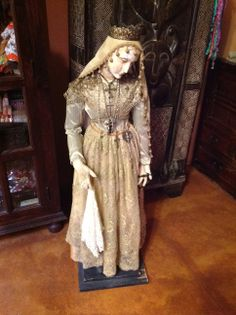 Treasures of the Gypsy showroom: Old Madonna dressed by Pamela Armas using treasures from her son Jeffery's studio, her mothers and grandmothers treasures.