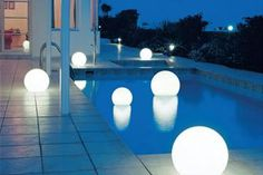 Good idea for the backyard! These Moonlight globe lights can be placed in a pool, hung from a tree, or incorporated into hardscape features like a patio. Love that soft glow. Contemporary Outdoor Lighting, Best Outdoor Lighting, Outdoor Decor, Decorative Lighting, Landscape Lighting, Lighting Ideas, Lighting Design, Modern Contemporary, Pool Plaster Colors