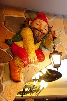 Gnome holding lantern in the entry way, I just adore this !!