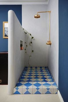 open shower | brass shower head | patterned tile floor | Greek inspired color palette | white + blue bath | baños | interiores | interior design | interior decor