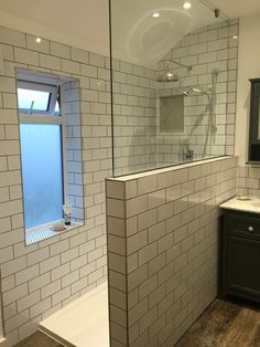 Make Photo Gallery Our new Bathroom with metro subway tiles and dark grey grouting with contrast penny tiles for the shower recess and window sill