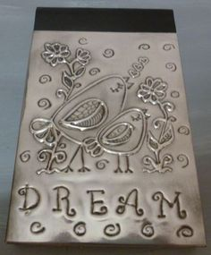 Dream Birds on small journal. Indented low relief.