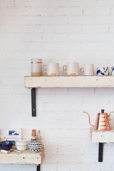 // copper kettle and ceramic mugs
