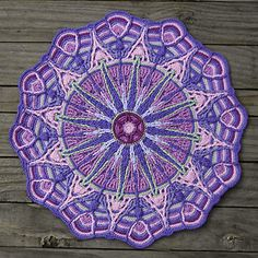 This mandala is worked in overlay crochet technique. This technique is deeply rooted in cable and Aran crochet. Overlay crochet created a symmetric textured design.