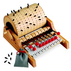 "The ""Gloggomobil,"" a wooden handcrank xylophone, is made with Swiss precision. Play 3 ways: push pegs into the wooden barrel & turn the crank to play musical compositions, strike the mallets directly on the xylophone keys, or remove the barrel and play from the back like a piano. Has a nice, bright sound. Fosters musical [...]"