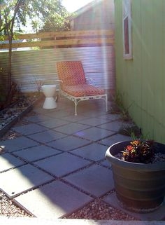 Patio with corrugated metal fence, designed and created by me, with some help from pinterst for inspiration.