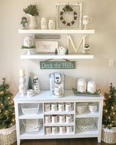 (@home_sweet_homedecor) Rae Dunn Christmas display with mugs canisters and some decals coffee bar hot chocolate station farmhouse coffee bar diy coffee bar shelves