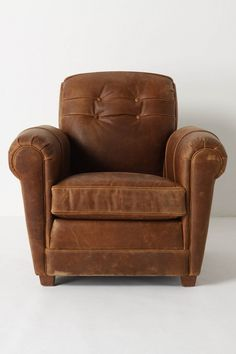 Perfectly and simply worn leather chair. bloodandchampagne.com