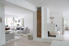 A place for firewood in the perfect white interior! Living Area, Living Spaces, Sweet Home, Modern Fireplace, White Fireplace, Wood Fireplace, Piece A Vivre, Scandinavian Home, Scandinavian Fashion