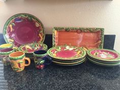 GREAT COLLECTION OF GATES WARE BY LAURIE GATES HAND PAINTED VEGETABLE PATTERN DISHES DECORATED WITH CHILI'S, RADISHES, EGGPLANTS, ETC. INCLUDES A RECTANGULAR SERVING TRAY (CORNER CHIP), A LARGE SERVING BOWL, FOUR SOUP BOWLS, FOUR DINNER PLATES, FOUR SALAD PLATES AND FOUR MUGS