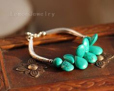 Water droplets group Songshi braceletMaterial: Tibetan silver, turquoiseSpecifications: Bracelet total length 16cm, and another 2-4cm longer of the chain, you can freely adjust the size.Weight:20g/$26.99