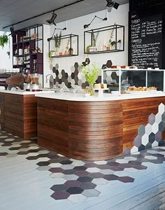 Ana foster-adams designed the interior of curators coffee gallery, a coffee shop in london that uses hexagons, wood, and a sophisticated yet playful color Kitchen Tiles Design, Cafe Interior, Tile Design, Bar Interior Design, Interior Design, Floor Design, Shop Interior Design, Cafe Bar Interior, Coffee Shops Interior