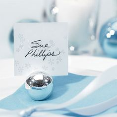 """An absolutely charming and perfect for any get together, whether it's a wedding, birthday or corporate event. This silver ball place card holder measures 1.12"""" diameter."""