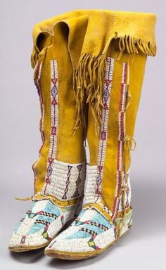 SOUTHERN PLAINS BEADED HIDE WOMANS HIGH-TOP MOCCASINS, ARAPAHO, C. LATE 19TH CENTURY, STAINED YELLOW, WITH FRINGE AT THE TOP, FULLY BE - AMERICAN INDIAN & ETHNOGRAPHIC ARTS - SALE 2291 - LOT 76 - Skinner Inc