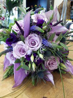 Purple tone brides bouquet with anthurium, ocean song roses, purple Veronica, purple list anthurium, thistles, wedding flowers
