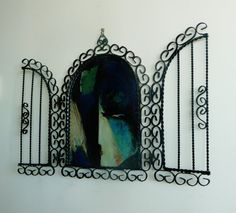 ☛SOLD by paroliro on ETSY to West Virginia.☚  1950s black wrought iron scrollwork versatile table top or wall arch mirror; lots of curlicues; twisted detail black vertical bars on doors. Hinged doors open fully to sides or partially. New Orleans or Spain gypsy boho style home decor. Perfect vanity table decorative focal point. Could also be hung outdoors on a fence, garden door or wall to give the illusion of a window to a secret garden.